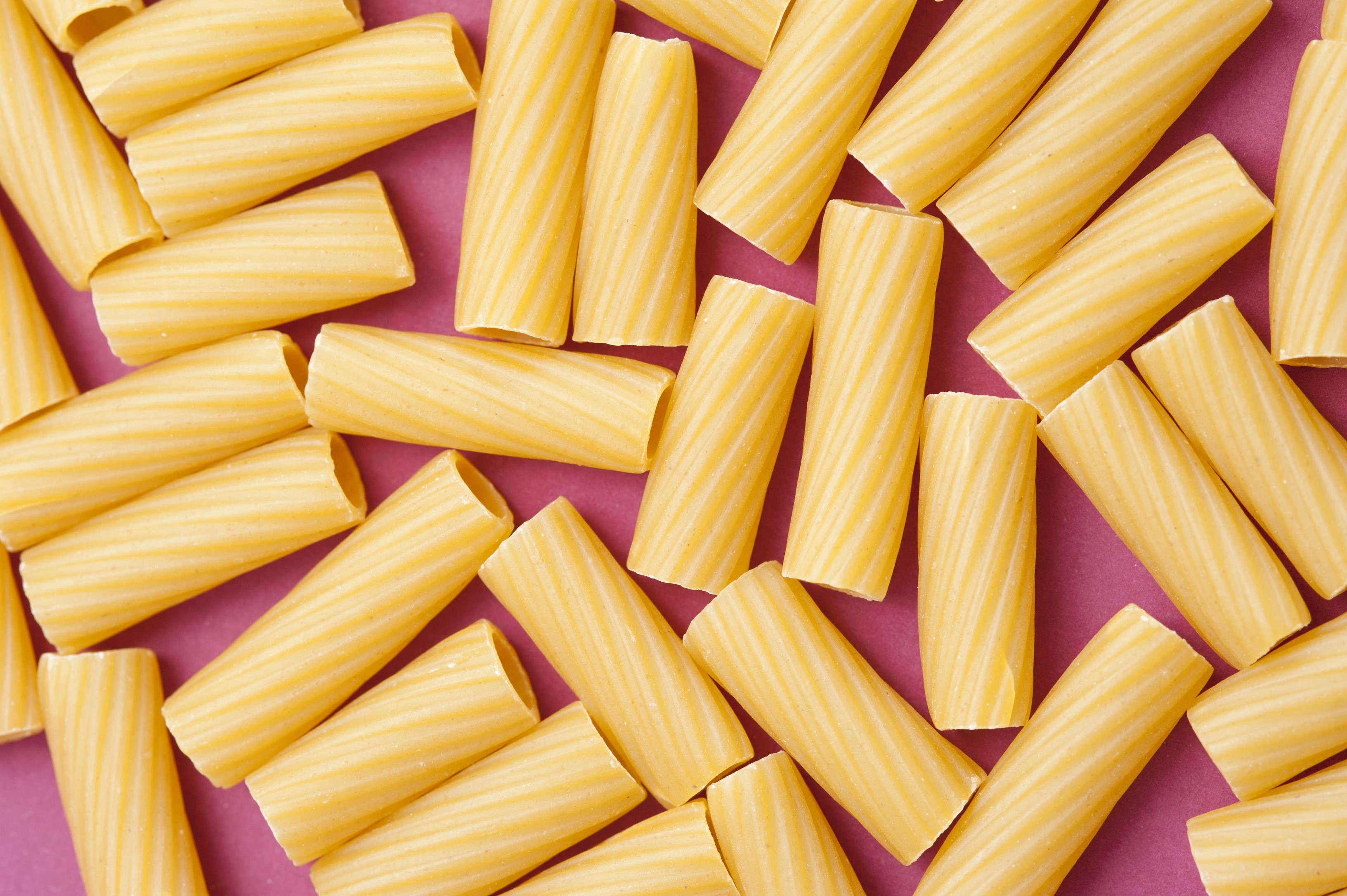 Overhead view of hollow dried pasta tubes made from durum wheat dough for use as an ingredient in Italian and Mediterranean cuisine