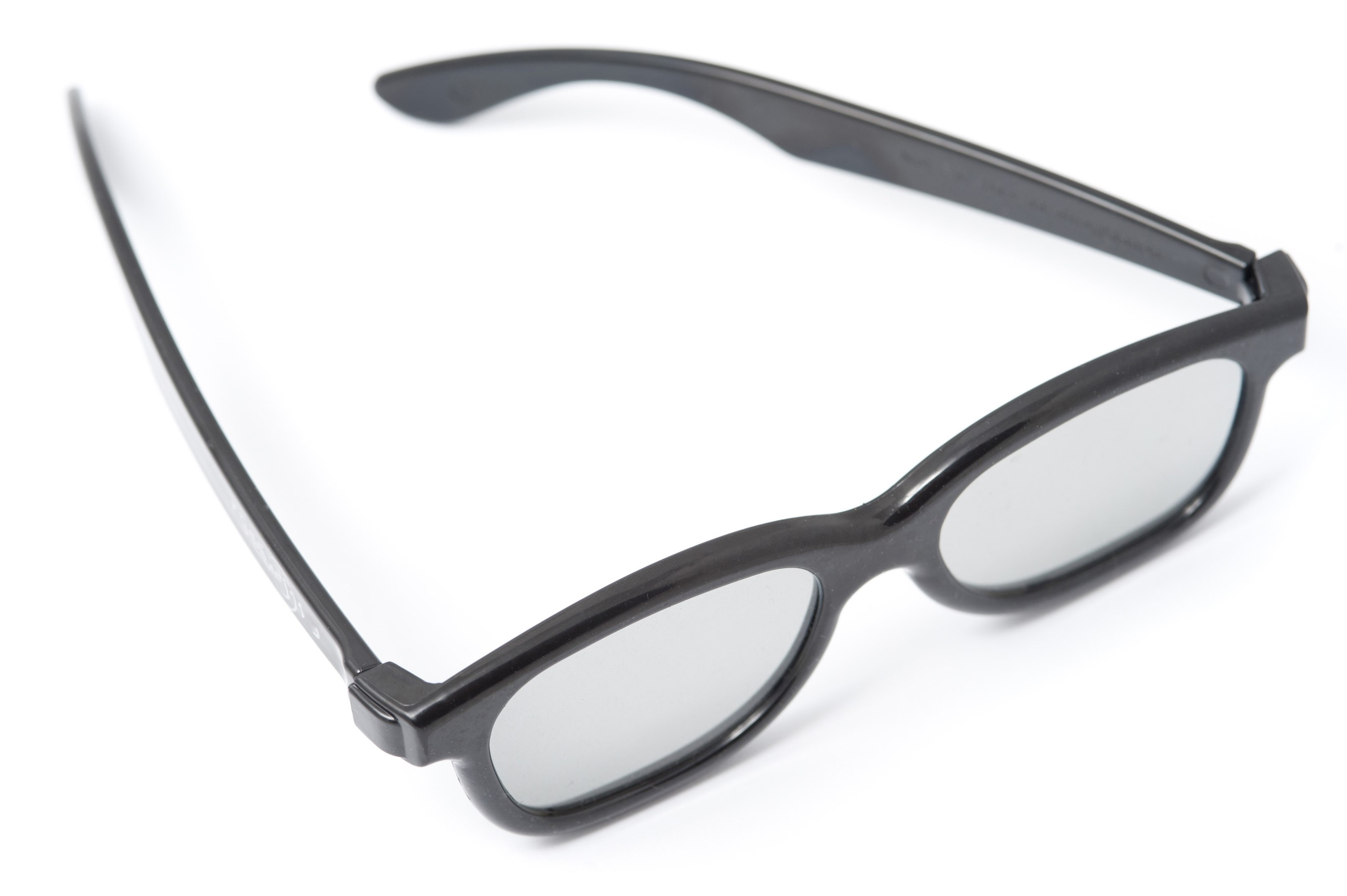 Retro glasses or spectacles with heavy black plastic frames on a white background, high angle view