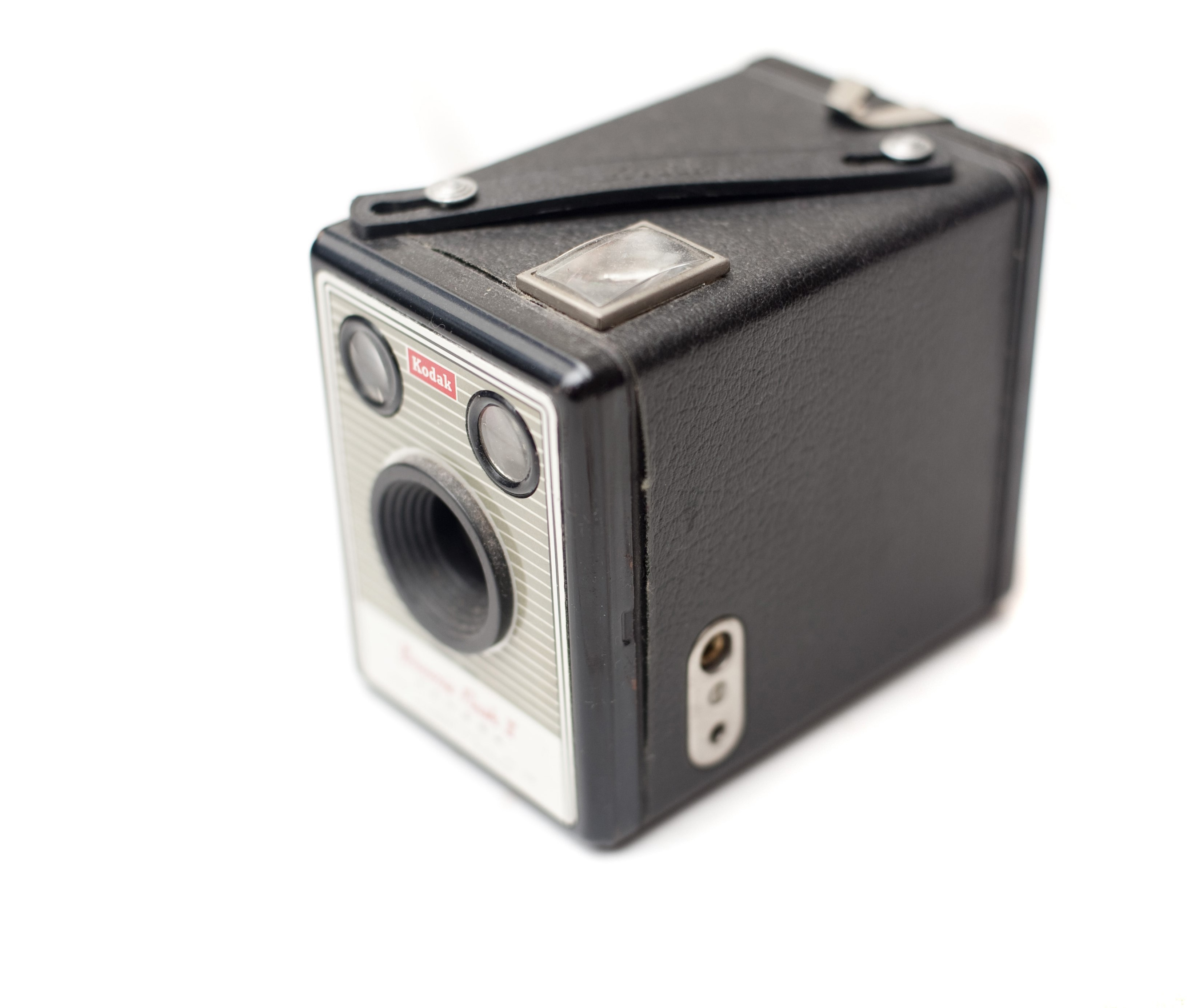 Old vinatge box camera on a white background, high angle view with shallow dof